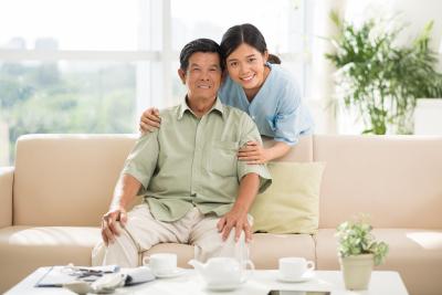 woman hugging a senior man