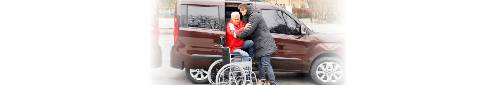 man helping senior man get off the car
